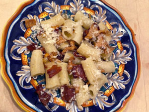 Fresh rigatoni pasta with black trumpet mushrooms, chanterelles and pancetta